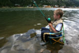 Mac Vaughn, 7, stays cool in Georgetown Lake,Wednesday afternoon, July 18, 2007. Vaughn was their...