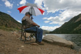 Jerry Huff (cq), Morison, stays cool while fishing at Georgetown Lake, Wednesday afternoon, July...