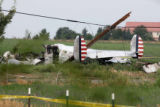 A WWII-era Beechcraft C-45 lays in a field in SW Weld County after crashing Thursday morning July...