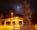 Lightning strikes behind a statue at Eagle Rim Park in Grand Junction Colorado  late Thursday...