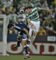 MLS All-Stars Brian Ching, left, and Celtic FC's Stephen McManus, right, connect on a header in...