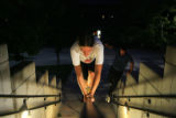 Carolynn Grigsby (cq), 15, of Boulder, catwalks on a handrail while practicing Parkour at CU...