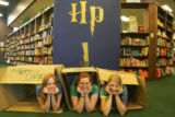 Portrait of Harry Potter fans Leigh Praskac (cq), 19, left, Kim Johnson (cq), 18, and Melanie...