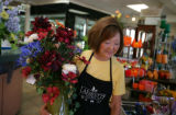 Evelyn Yoshihara carries an arrangement out for a customer for her family business Lafayete...