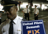 Noel WIlliams(cq), a United Airlines pilot for nine years, marches outside of the United ticket...