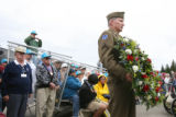 Scott Koske, cq, of the 10th Mountain Living History Display Group, holds a wreath that will be...