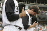 0023 Colorado Rockies captain Todd Helton bows his during a moment of silence for Double A Tulsa...