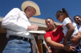 (Denver, Colo., September 6, 2004) U.S. Senate candidate Ken Salazar, left, signs a copy of...