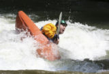 Eric Gillaspy, (cq) tackles the tough waves in the river adjacent to the park in Golden, Colo. on...