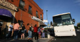 Passengers wait to board a bus at the Los Paisanos Bus Company, 22nd and Welton, that will travel...