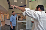 L to R: Postal employee Joe Trujillo (cq) expalins  parking garage access to customer Chaim Abrams...