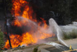 (BAILEY, CO., MAY 20, 2004)  A member of the Platte Canyon Fire Protection District sprays foam...