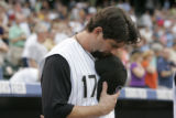 0003 Colorado Rockies captain Todd Helton bows his during a moment of silence for Double A Tulsa...