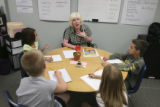 Mrs. Susie Haight helps kids perfect their reading skills....clockwise from Mrs. Haight, Austin...