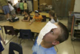 Michael Soukup, (cq), invents a way to balance a piece of paper on his face as art class breaks...