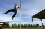 Ryan Ford (cq), swings from a pole while practicing Parkour in Boulder, Colo., on Thursday, May...