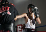 Robert Rodriguez,17, right, tries to land a punch against 17-0 (KO-11) Welerweight fighter Mike...