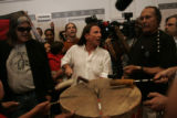 Glenn Morris (cq), center, a teacher at CU Denver and a Churchill supporter, drums with Ward...