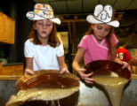 Lauren  Decker, 9, left and her sister Meghan Decker, try their luck at panning for gold,...