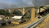 A portion of the I-35W bridge over the Mississippi River collapsed during the evening rush hour in...