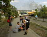 An injured woman is assisted on the sidewalk along the West River Parkway after a portion of the...