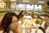 (From front to back) Patricia Shaw(cq)  takes a break from searching for houses to eat at Wendy's...