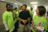 New Principal Rob Stein, center, talks with volunteers in the hallway at Manual High school in...