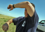 Aurora Reservoir Ranger Tony Lessley (cq) wipes his forehead after mowing  down weeds near the...