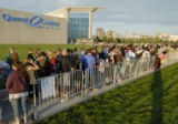 NEDW101 - **RECROPPED VERSION**Thousands of people wait in line at sunrise, Friday, Aug, 10, 2007,...