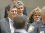 0363 Former Qwest CEO Joe Nacchio, left, leaves the Alfred A. Arraj Federal Courthouse locked...