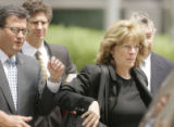 0372 Former Qwest CEO Joe Nacchio, leaves the Alfred A. Arraj Federal Courthouse with his wife...