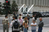 On lookers gather near the Alfred A. Arraj courthouse Friday July 27, 2007 to find out the...