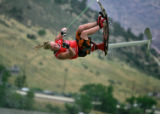 Darren Narens (CQ), gets some air as he competes in the advance division preliminaries Flip Out,...