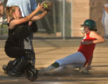 [(Aurora, CO,Shot on: 9/7/04)] Smokey Hill's Jenn Bledsoe, right, slides into home for the winning...