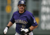 Colorado Rockies infielder Troy Tulowitzki rounds the bases after his solo shot home run as he...