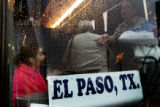 "Dozens of passengers board a bus bound for El Paso, Texas, at ""El Paisano"" bus lines in..."
