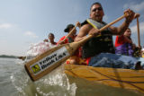 "The ""Premier Dinasty"" team rows their dragon boats off the shore, as they prepare to..."