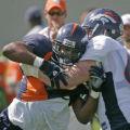 0396 Denver Broncos defensive end #96 Tim Crowder tries to get around teammate #69 Jacob Rogers, a...