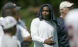 0537 Denver Broncos team captain Rod Smith tries to escape the sun with a towel on his head during...