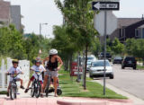 Darcey Bar-on (cq) picks up her kids at the Odyssey School in Stapleton. She rides her bike...