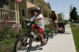 Darcey Bar-on (cq) picks her kids at the Odyssey School in Stapleton. She rides her bike everyday...