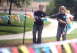 L to R: Alex Gutheil (cq),16, and Amanda Dunn (cq), 16, put up flag markers in the parking area of...