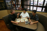 left to right, Hunter Fiscus, D.J. Freeman and Jimmy Nguyen (cq all), talk and look over the menu...