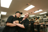 Frank Lozano, kitchen manager, jokes around in the kitchen before crunch time with Anneka Kern,...