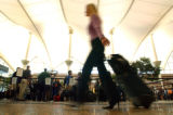 (DENVER, Co., SHOT 9/22/2004) Record numbers of travelers passed through DIA in the month of July....