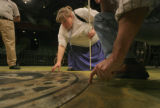 Visitor, Karen Samuelsen (cq), who is visually impaired feels the edges of an area on stage of...
