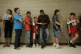 North High School had long lines of people waiting to register for school Tuesday, August 14,...