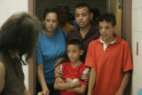 Maria Robledo, and her sons Manuel Robledo, 16, (far right) a sophomore, Jesus Robledo, 9, a...