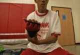 Robert Rodriguez,17, puts on protective gloves before boxing practice at the Jesus Rodarte...