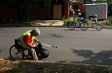 Artie Guerrero (cq) ,part of a team of volunteers from Wells Fargo , cleans trash on 27th near...